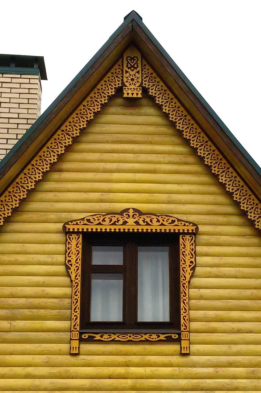 Украшение фронтона дома фото